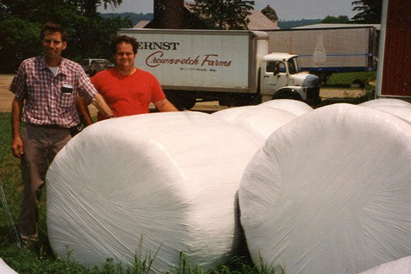 Calvin-and-Andy-Ernst-pose-in-front-of-an-Ernst-Crownvetch-Farms-truck-in-the-1993
