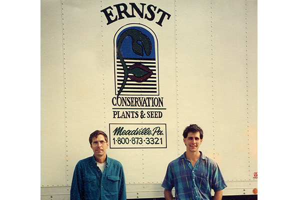 Calvin-and-Michael-Ernst-pose-in-front-of-an-Ernst-Conservation-Seeds-truck-in-1995